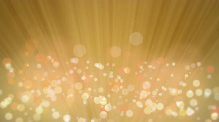 Rays of Light with Elegant Gold Bokeh Background.