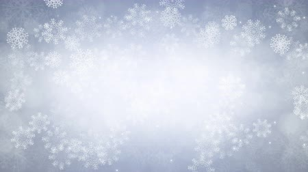 New Year background. Snowflakes and sparkles are slowly flying. Computer generated seamless loop abstract animation.