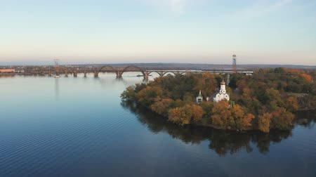 Autumn panoramic aerial top view of church on Monastic island on Dnieper river in Dnipro city.