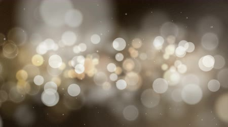 Abstract holiday bokeh background. Circles with particles are slowly flying. Seamless loop digital animation.