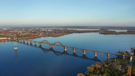 Aerial top view from drone on railway bridge above Dnieper river in Dnipro city. Autumn landscape and cityscape background. (Dnepr, Dnepropetrovsk, Dnipropetrovsk) Vídeos
