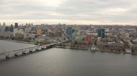 4K Aerial view footage of Dnieper river and city center skyline. Urban life from drone eye view. Flying over cityscape with buildings.