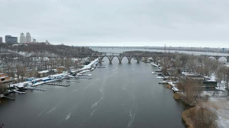 Video footage of flying over Dnieper river between Monastic island and shore in Dnipro city, Ukraine. Aerial view from the drone. Dostupné videozáznamy