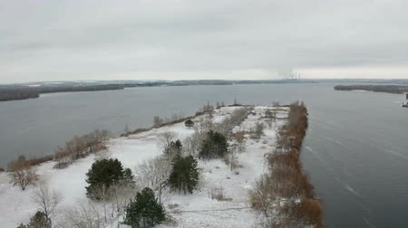 Video footage of flying over Monastic island in the middle of the Dnieper river at winter time. Snow lies on the ground. Aerial view from the drone. Dostupné videozáznamy