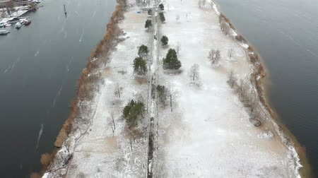 Video footage of flying over Monastic island with snow on the ground in the middle of the Dnieper river at winter time. Aerial view from the drone. Dostupné videozáznamy