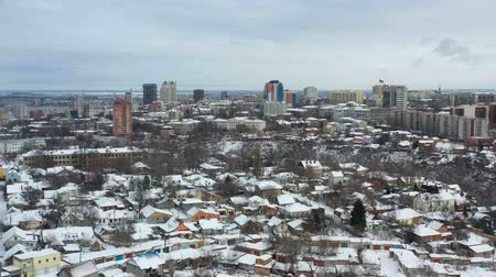 Fly up over cityscape of Dnipro city at winter. 4K Urban aerial view from drone on downtown with buildings. (Dnepr, Dnepropetrovsk, Dnipropetrovsk). Ukraine. Dostupné videozáznamy