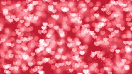 Romantic Mothers Day motion background with hearts bokeh. Seamless loop Valentines Day holiday animation.