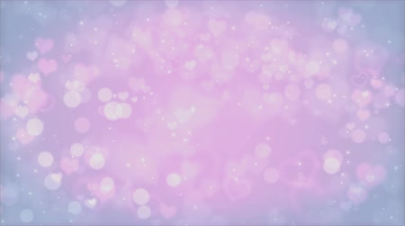 Romantic hearts bokeh background. Seamless loop animation for Valentines Day or Mothers Day holiday. Looped 4K motion graphic.
