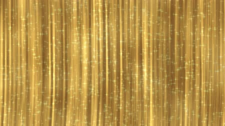Gold curtain with glittering particles. Seamless loop abstract animation. Looped 4K motion background.
