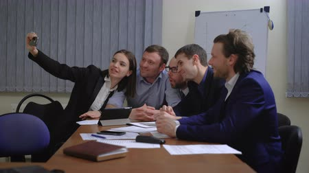 сотрудники : Business people making face while taking selfie in office