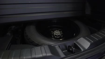 roomy : Spare tire in the trunk of a modern car. Stock Footage
