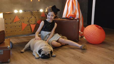 kobieta pies : Little girl sitting near retro a suitcase with dog. Wideo