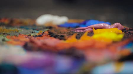 pallette : Artists oil paints multicolored closeup abstract Stock Footage