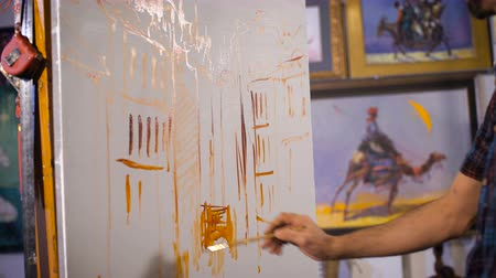 expressionism : Artist start painting on the canvas which lay on the  tripod paint.