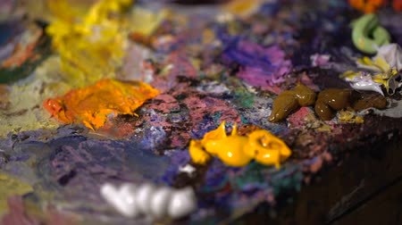 paletta : Artists oil paints multicolored closeup abstract background Stock mozgókép