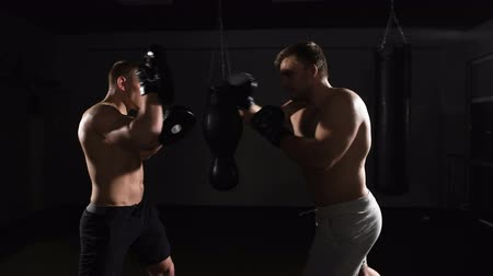 bokszoló : Two boxing men exercising together at the health club