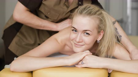 massager : Woman in massage. Young attractive girl smiling with a massage. Stock Footage