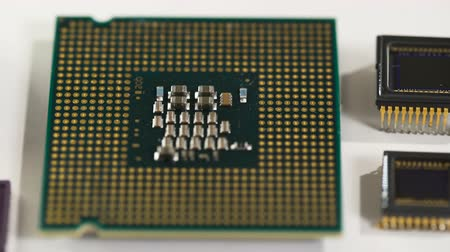 chip and pin : computer processor and electronic components on white background