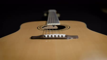 headstock : light yellow acoustic guitar close-up. Modern design Stock Footage
