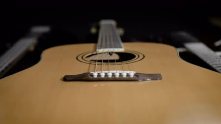 lesson : light yellow acoustic guitar close-up. Modern design Stock Footage