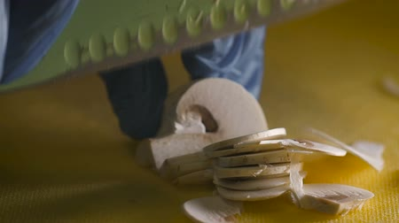 shiitake : White mushroom complete and sliced with a knife on plastic board Stock Footage