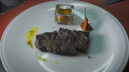 grelha : fried steak, beautifully laid on a plate with sauce and chili