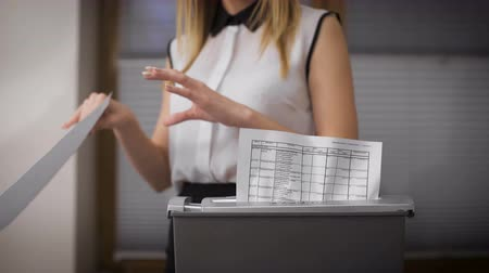 ídolo : Secretary destroys documents using a special apparatus. Hiding confidential financial information. Stock Footage