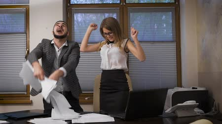 kutluyor : The young girl and the guy in the office. Successful completion of the transaction through the Internet, elation and emotion. Young business people celebrate their success.