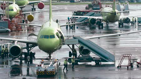airplane engine : Infrastructure International Airport. Planes at the site, the staff make the necessary maintenance work Stock Footage