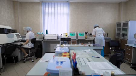 bio hazardous : Work in a medical laboratory. In the frame, two nurses or doctors, they are engaged in the analysis of samples obtained from patients.