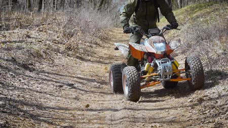 quadro : Scaffold. Off road terrain. The man on the ATV. The racer studies driving on off road terrain at the special car.