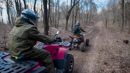 quadbike : Extreme vacation in the woods on the ATV. Men engage in motor sport, quad bike is an ideal means for riding on country roads. All wheel drive helps to overcome obstacles, and to conquer the terrain