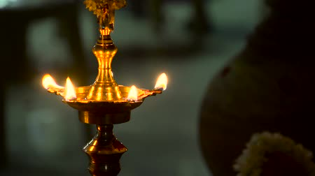 divinity : Closeup shot south indian oil lamp shot. Beautiful Light Golden color Stock Footage