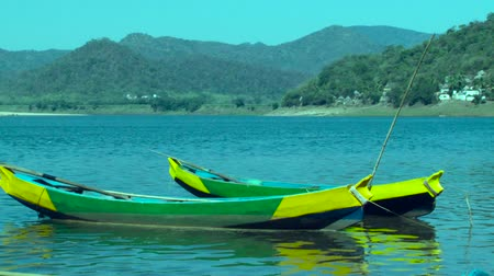 mooring : Closeup shot boat, nice color painting and beautiful hills background. Stock Footage