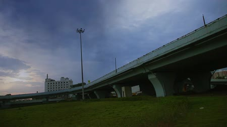 estrutura construída : Dark clouds moving over the bridge fast, after the rain evening time dark blue sky.