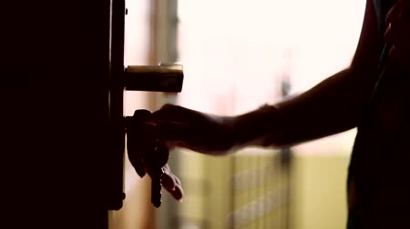 kapualj : closeup shot hand, Woman closing the door and key unlocks the door