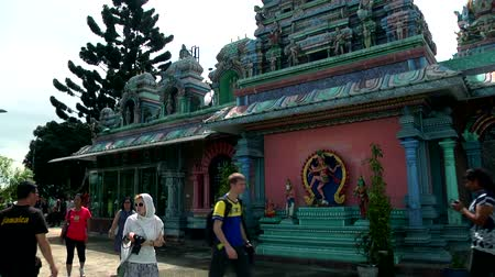 batu caves : Hindu temple exterior shot in Malaysia, Hindu devotees. tourist peoples Stock Footage