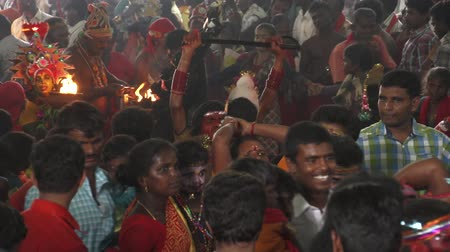 театральный : Devotees dancing in crowd at Hindu festival in Sri Mutharamman Temple at Thoothukudi district,Tamilnadu,India