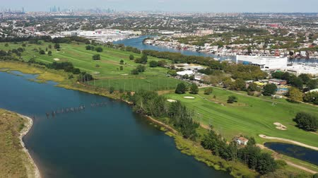 curso : aerial view of golf course, marina, city and ocean 4k