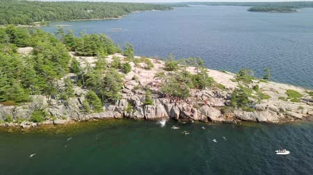 leaping : Aerial view of cliff jumpers in Killbear provincial park