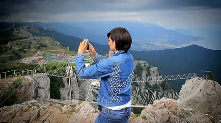 alma : girl making a panorama in the mountains on the smartphone HD