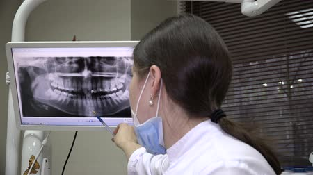 stomatologia : Dentist Shows At Screen Image Of Healthy Teeth