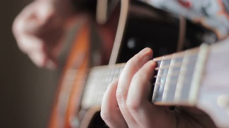 playing band : Man with Tatoo playing acoustic guitar Stock Footage