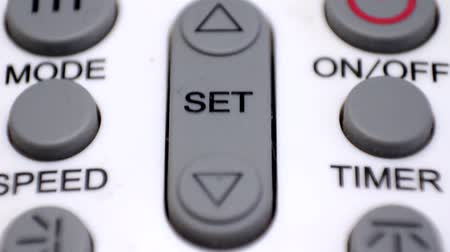 temp : macro of an air conditioner remote control Stock Footage