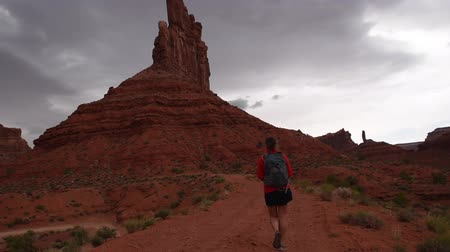 overlooks : Woman Hiker Backpacker walking through the Valley of the Gods