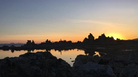 mono lake : Sun Rising Behind South Tufa Calcium Limestone Rock Formations Mono Lake California
