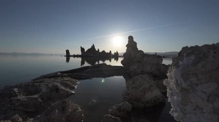 mono lake : Mono Lake Tufa Towers Reflection in the water at Sunrise Wide Angle low slow tracking shot Stock Footage
