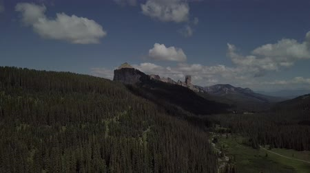 aro : West Fork Cimarron River leads to Chimney Rock and Courthouse Mountain Stock Footage