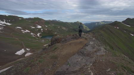 free range : Girl Hiker walks along steep mountain ridge San Juan Mountains Colorado