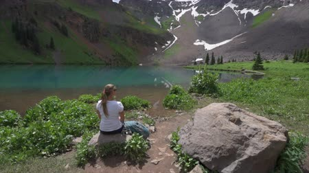rocky mountains : Hiker looks at Blue Lake Ridgway Colorado